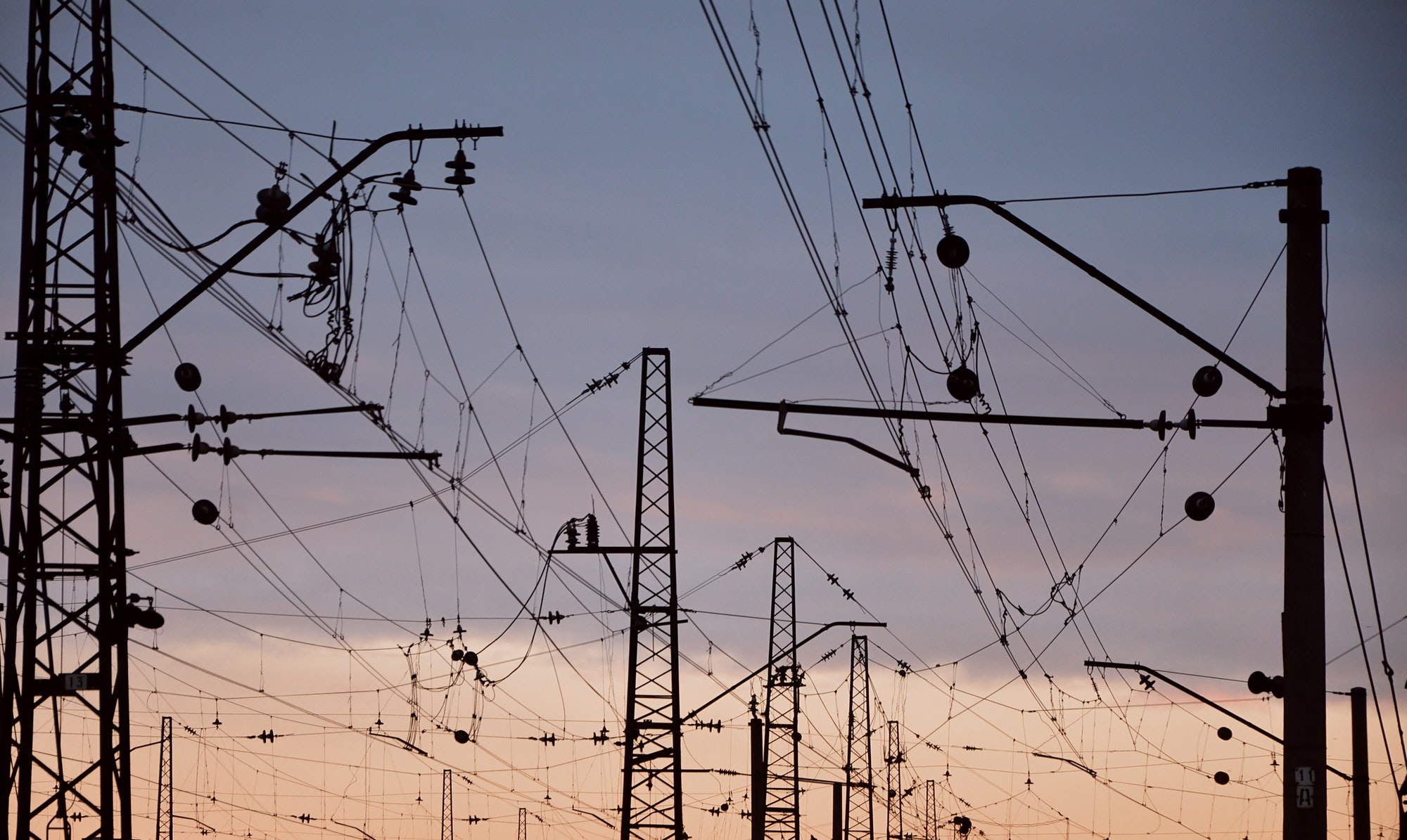 Railroad overhead lines against clear blue sky, Contact wire